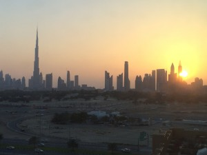 Dubai skyline at sunset - Burj Khalifa towering above other buildings