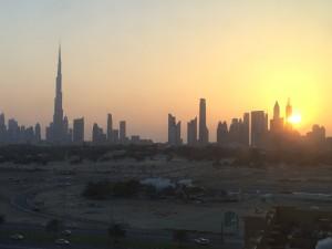 Dubai skyline at sunset - Burj Khalifa towering above other buildings
