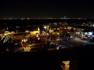 From the second floor seating area, the Kalochi restaurant alive and sparkling at night along the ocean