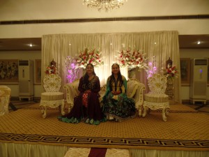Young girls in the wedding hall dressed up to celebrate their cousin's wedding